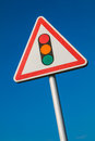Warning sign with a picture of a traffic signal Royalty Free Stock Photo