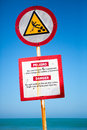 Warning sign preventing not to walk on rocks in Cartagena Royalty Free Stock Photo