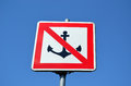Warning sign prohibit ship moor riverside blue sky Royalty Free Stock Photo