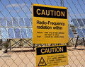Warning sign for radio frequency radiation at solar plant Stock Image