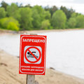 Warning sign on the river - bathing is forbidden, dangerous to l Royalty Free Stock Photo