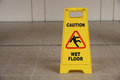 Warning sign of wet floor yellow slippery Stock Photo