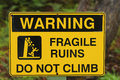 Warning sign yellow and black of fragile ruins Stock Images