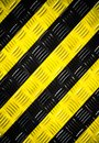 Warning sign yellow and black stripes painted over steel checker diamond plate on the floor or wall as texture background. Royalty Free Stock Photo