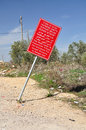 Warning signboard red about entrance to palestinian settlement central israel Stock Photography