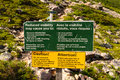 Warning signs at the base of gros morne mountain on the james callaghan trail Royalty Free Stock Photography