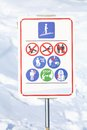 Warning symbols road sign in winter mountains Royalty Free Stock Photography