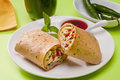 Warp alternative taco or burrito which includes traditional sandwich fillings wrapped in a tortilla Royalty Free Stock Image
