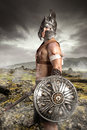 Warrior ancient posing outdoors with swords ready for battle Stock Photo