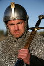 Warrior in chain mail, sword resting on shoulder Royalty Free Stock Images