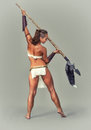 Warrior girl ancient. Poke with a spear. Royalty Free Stock Photo