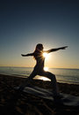Warrior II yoga pose on beach Royalty Free Stock Image