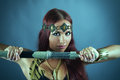 Warrior woman holding sword in her hand young Royalty Free Stock Photo