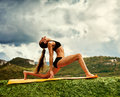 Warrior yoga pose slim young woman makes Royalty Free Stock Photos