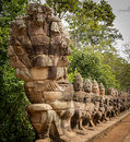 Warriors line entrance to south gate angkor thom Stock Images