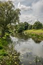 Warwick castle mill pond grounds river leading to the english countryside Royalty Free Stock Photos