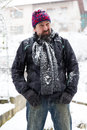 Wary man standing in a snowy garden Stock Image