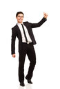 That was easy happy young man showing thumb up full length studio shot isolated on white Stock Image