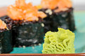 Wasabi with baked sushi rolls on turquoise plate Royalty Free Stock Photo