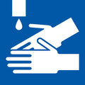 Wash hands sign on blue background Stock Image