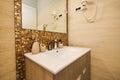 Washbasin in the bathroom. Plumbing in the bathroom. The interio Royalty Free Stock Photo