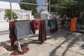 Washed clothes monks in a place to wash up in the shwenandaw monastery in myanmar burma Royalty Free Stock Photography
