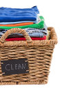 Washed fresh clean clothes in a laundry basket close up view of neatly folded and stacked rustic wicker with handwritten label Royalty Free Stock Images