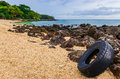 Washed out tyre at beautiful ocean coast in andaman sea thailand Stock Photos