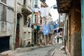 Washed shirts on a rope between old houses of narrow street of Istanbul Royalty Free Stock Photo