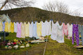 Washing on a clothesline colorful hung out to dry in rural setting Stock Images