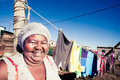 Washing day curvaceous african woman happily doing her in the townships Royalty Free Stock Photography