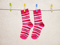 Washing day, Socks drying on a string Royalty Free Stock Photo