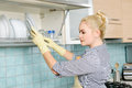 Washing the dishes young woman in kitchen Stock Images