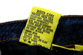 Washing jeans instructions yellow tag attached with the informs and guides Royalty Free Stock Photo