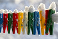 Washing line row colorful pegs covered snow queued row Stock Photo