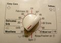 Washing machine controls buttons to set the schedule temperature spin cycle etc Royalty Free Stock Photo