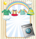 A washing machine with hanging clothes at the top illustration of Stock Image