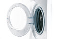 Washing machine with an open door detail Royalty Free Stock Photo