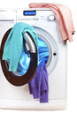 The washing machine with an open door and linen Royalty Free Stock Photo