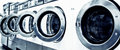 Washing machines industrial in a public laundromat Royalty Free Stock Photography
