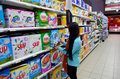 Washing powder woman selecting in a supermarket image taken on the th of december in intermarche supermarket in the algarve Royalty Free Stock Photography