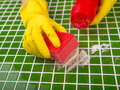 Washing the tiles in the bathroom Royalty Free Stock Photo