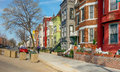 Washington dc rainbow row houses brightly painted line the street just off new york avenue in northwest and are being identified Royalty Free Stock Photography