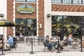 Washington DC, USA - September 24, 2016: Outside seating area of Potbelly fast food restaurant with sign and people eating lunch Royalty Free Stock Photo