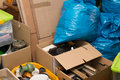 Waste in a apartment and cardboard boxes an Royalty Free Stock Photo