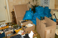 Waste in a apartment and cardboard boxes an Stock Image