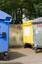 Waste container blue paper yellow recycling and a metal Stock Images