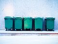 Waste containers five green in a row Royalty Free Stock Image