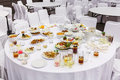 Waste food after dinner on round table in party room Stock Images