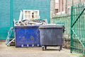 Waste skip a and a large bin at a building site Stock Image